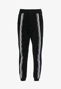 adidas Originals - CUFFED PANTS - Joggebukse - black - 3
