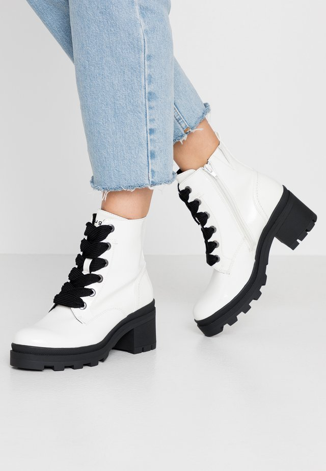 FRIEDA - Platform ankle boots - offwhite