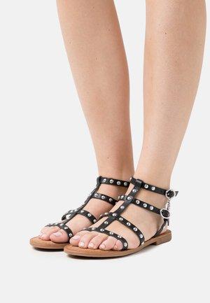 GUGAN - Sandals - black