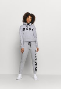 DKNY - EXPLODED LOGO CUFFED - Tracksuit bottoms - pearl grey heather - 1