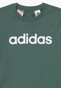 adidas Performance - LIN UNISEX - T-Shirt print - teceme/white - 2