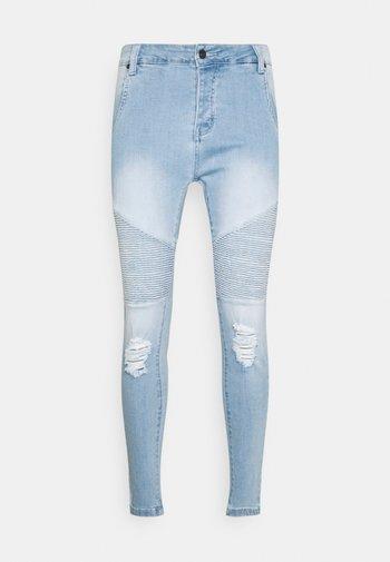 DISTRESSED BIKER - Slim fit jeans - light blue