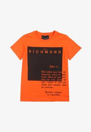 T-shirt con stampa - arancione