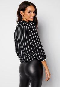 Bubbleroom - JULIETTE SS KNOT - Button-down blouse - black - 2