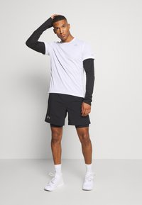 Under Armour - LAUNCH 2-IN-1 SHORT - kurze Sporthose - black - 1
