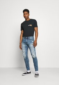 American Eagle - MEDIUM MENDED - Jeans Skinny Fit - indigo fray - 1