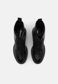 Tamaris - Platform ankle boots - black - 5