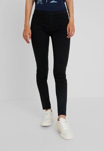 TREGGINGS - Trousers - black