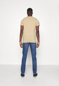 Levi's® - 512™ SLIM TAPER LO BALL - Slim fit jeans - dolf hard knock adv - 2