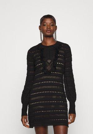 MINI ABITO IN MAGLIA TRAFORATO CON FRANGE - Stickad klänning - nero