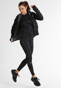 Newline - BASE WARM UP - Sports jacket - black - 1