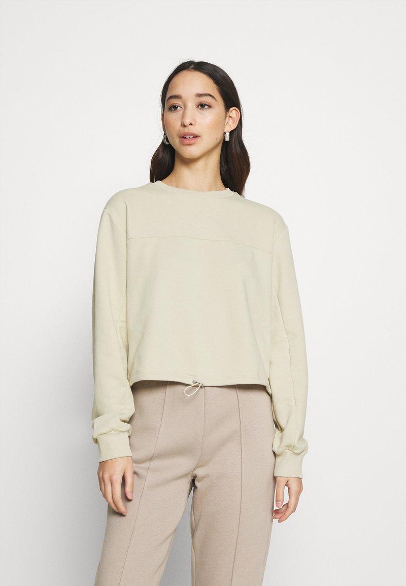 NA-KD - CROPPED DRAWSTRING - Sweatshirt - beige