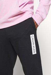 Calvin Klein Performance - PANTS - Pantaloni sportivi - black - 4