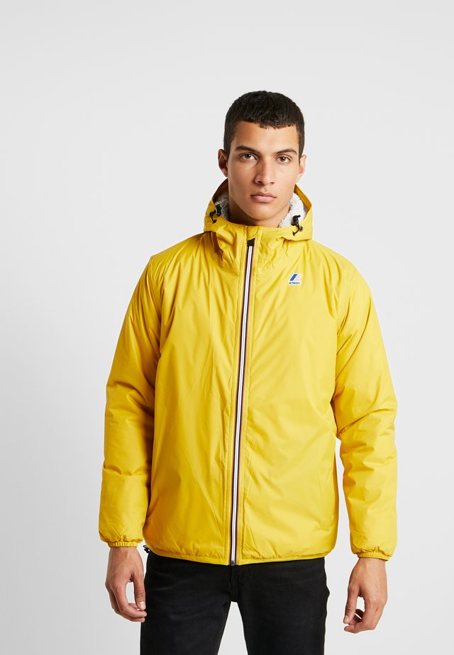 UNISEX CLAUDE ORESETTO - Light jacket - yellow mustard