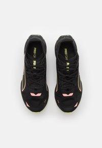Puma - ULTRARIDE - Neutral running shoes - black/elektro peach/soft fluo yellow - 3