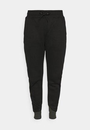 PREMIUM TAPERED PANT - Trainingsbroek - black