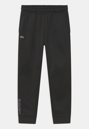 TECH UNISEX - Tracksuit bottoms - black