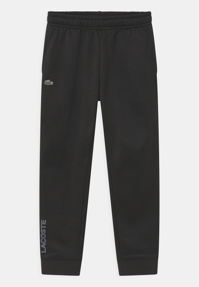 TECH UNISEX - Teplákové kalhoty - black