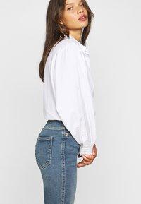 Dr.Denim Petite - MOXY  - Flared Jeans - eastcoast blue - 4