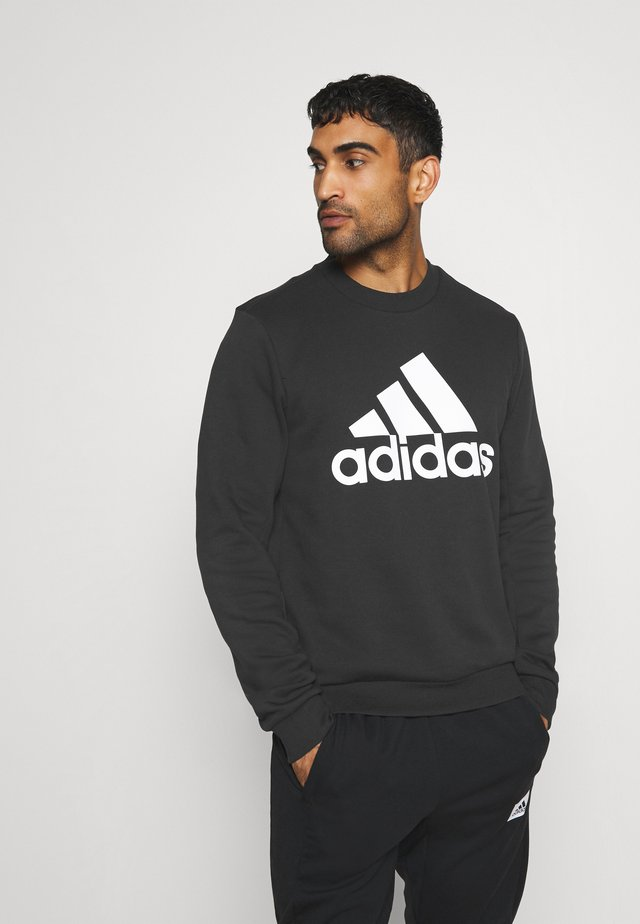 ESSENTIALS SPORTS - Sudadera - black
