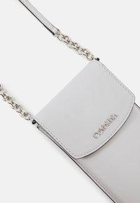 Calvin Klein - PHONE POUCH XBODY - Phone case - grey - 3