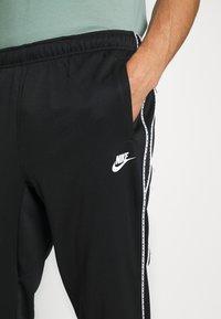 Nike Sportswear - REPEAT - Tracksuit bottoms - black - 5