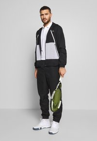 Lacoste Sport - TRACKSUIT HOODED - Tracksuit - black/white - 1