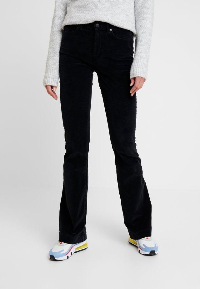 TARA FLARE BABY - Trousers - black