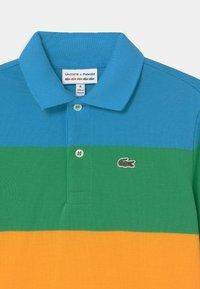 Lacoste - LACOSTE X POLAROID  - Polo shirt - fiji/malachite/gypsum/orpiment/corrida - 2