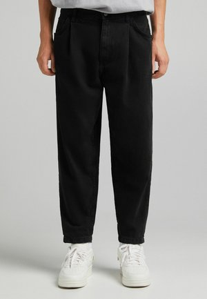 TAPERED - Straight leg jeans - off-white