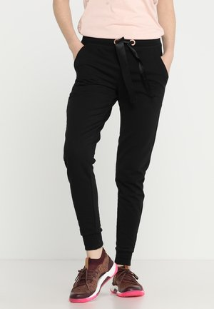 SKINNY - Tracksuit bottoms - black