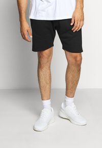 Common Kollectiv - PLUS FLASH  - Tracksuit bottoms - black - 0