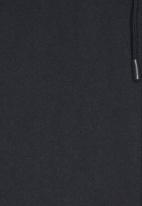 Urban Threads - CUT & SEW SIDE PANEL - Tracksuit bottoms - dark blue - 2