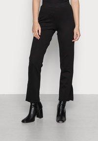 Pieces Petite - PCKARLA SLIT - Leggings - Trousers - black - 0