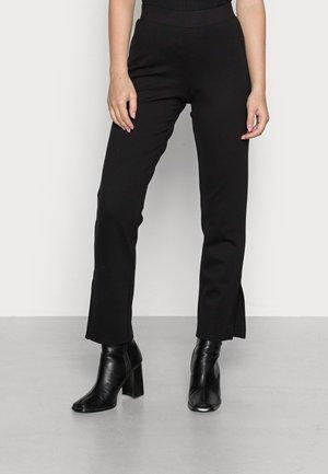 PCKARLA SLIT - Leggings - Trousers - black
