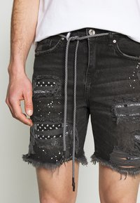 The Couture Club - BANDANA PATCH AND PAINT SPLAT CUT OFFS - Denim shorts - washed black - 4
