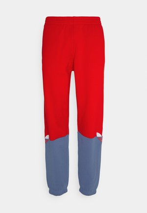 SLICE - Tracksuit bottoms - scarlet/crew blue