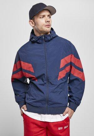 CRINKLE PANEL - Outdoor jacket - darkblue/cityred