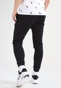 Nike Sportswear - CLUB JOGGER - Tracksuit bottoms - black - 2