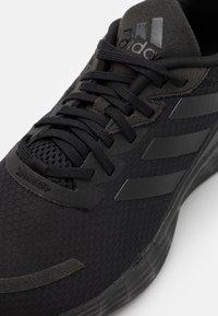 adidas Performance - DURAMO - Neutrální běžecké boty - core black - 5