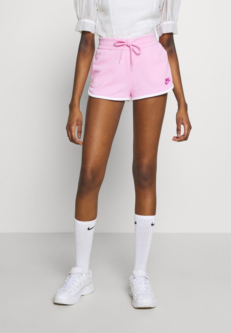 Nike Sportswear - Tracksuit bottoms - pink