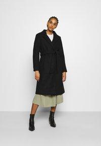 ONLY - ONLBERNA WRAP COAT - Klasický kabát - black - 2