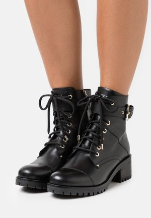 LIYRA - Lace-up ankle boots - black
