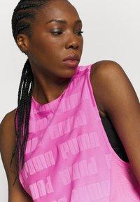 Puma - TRAIN FIRST MILE XTREME TANK - Sports shirt - luminous pink - 3