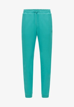 HADIKO - Tracksuit bottoms - turquoise