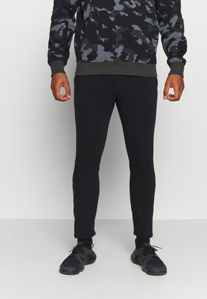 ISAM TAPERED PANTS - Tracksuit bottoms - black