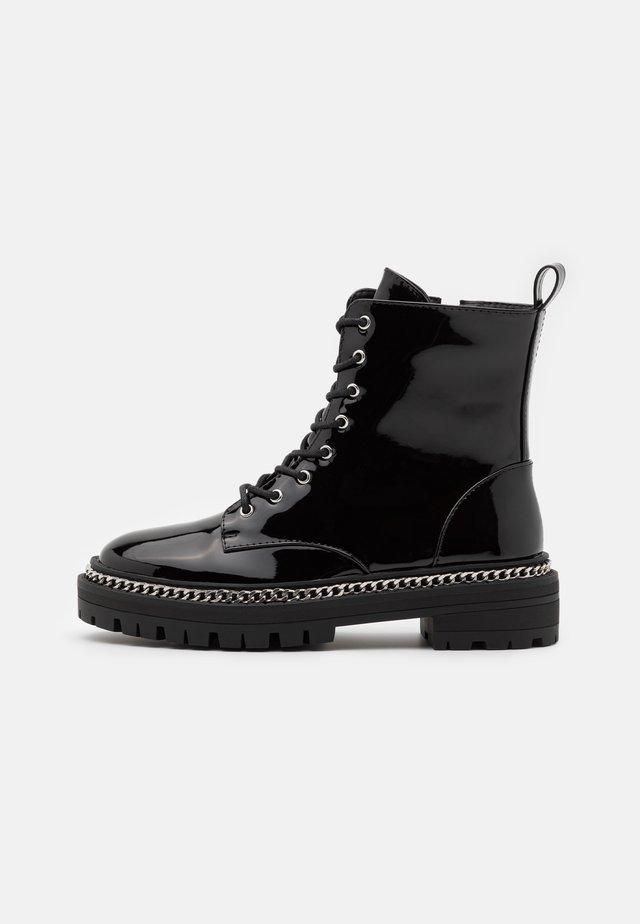CARSON - Veterboots - black