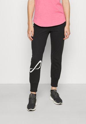 PANTALON ESSENCE - Pantalon de survêtement - black