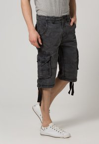 Alpha Industries - JET - Cargo trousers - black camo - 2
