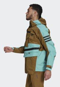adidas Performance - XPLORIC RAIN JACKET - Hardshell jacket - wild moss/acid mint - 4